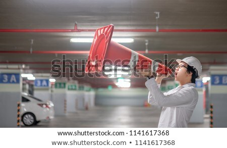 Worker shouting into traffic cone Stock photo © photography33