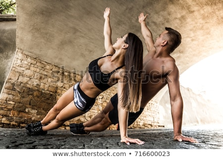 Couple practising yoga outside Stock photo © photography33