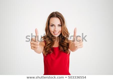 Pretty girl in santa outfit smiling at camera Stock photo © wavebreak_media