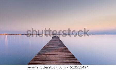 The bridge is reflecting in the calm water Stock photo © olandsfokus