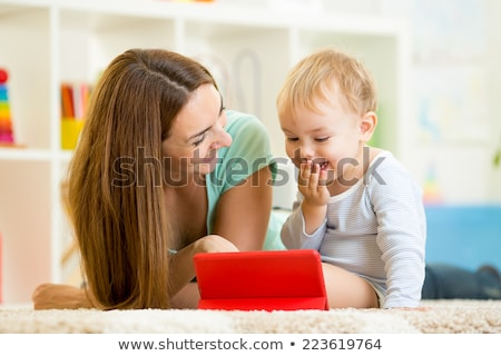 Toddler playing with tablet stock photo © unkreatives