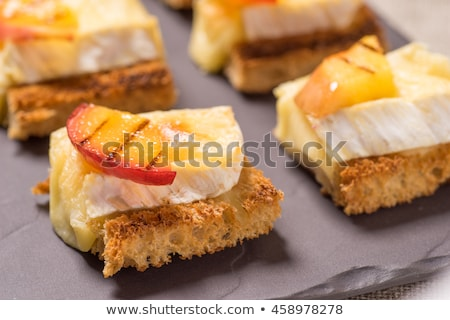 canapes with grilled brie and nectarine Stock photo © Klinker