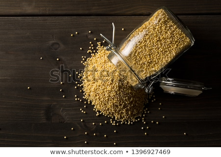 jar of raw millet grains Stock photo © Digifoodstock
