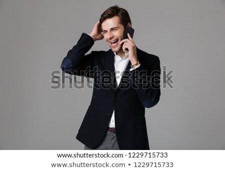 vrolijk · bebaarde · vent · zwart · pak · mobiele · telefoon - stockfoto © deandrobot