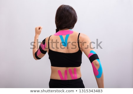 Woman Running With Physio Tape On Her Body Stock photo © AndreyPopov