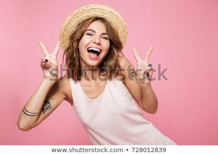 boldog · lány · mutat · kézmozdulat · emberek · gyerekek · titkolózás - stock fotó © deandrobot