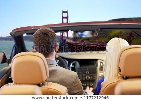man at convertible car over golden gate bridge Stock photo © dolgachov