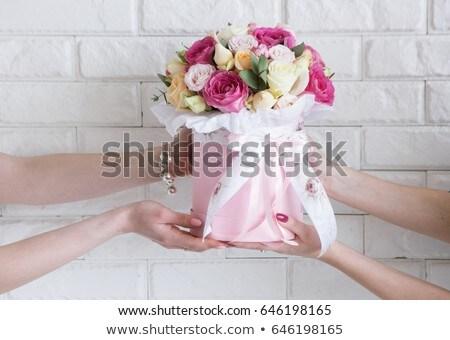 female customer receiving flower bouquet stock photo © kzenon