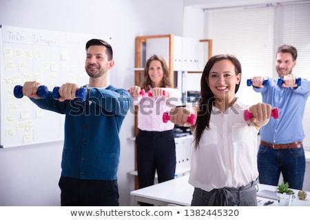 女性実業家 · 行使 · ダンベル · 笑みを浮かべて · 小さな · 赤 - ストックフォト © andreypopov