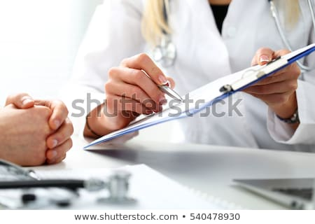 health care and medical concept female doctor hand hold pen fil stock photo © freedomz