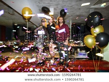 счастливым девочек элегантный парень вечеринка Сток-фото © pressmaster