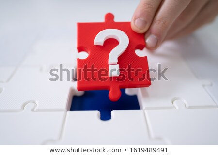 Person Placing Question Mark Piece Into Jigsaw Puzzle Stock photo © AndreyPopov