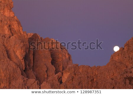 Moon over cliffs in the evening  Stock photo © Balefire9