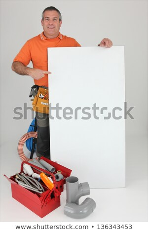 Workman with a board left blank for your message Stock photo © photography33