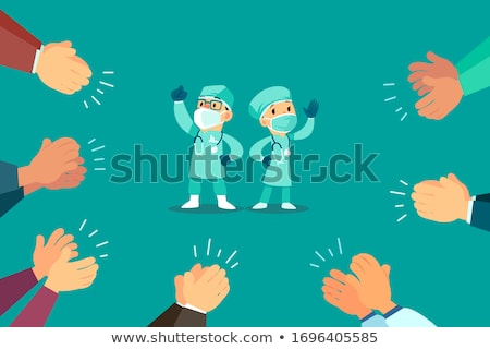 Nurses clapping a doctor Stock photo © wavebreak_media