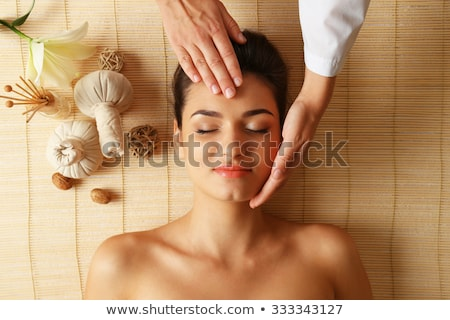 woman head and hands on bamboo mat Stock photo © chesterf