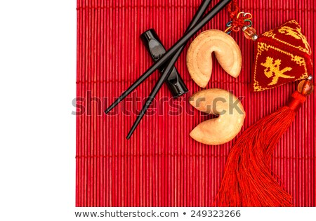 Fortune cookies on bamboo mat Stock photo © andreasberheide