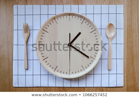 Clock on wooden table Stock photo © fuzzbones0