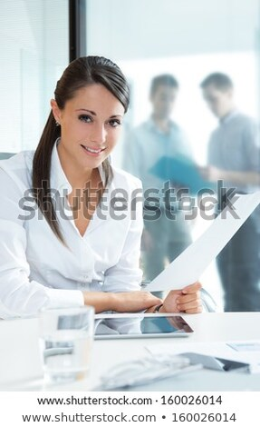 vertical image of business woman with documents stock photo © deandrobot