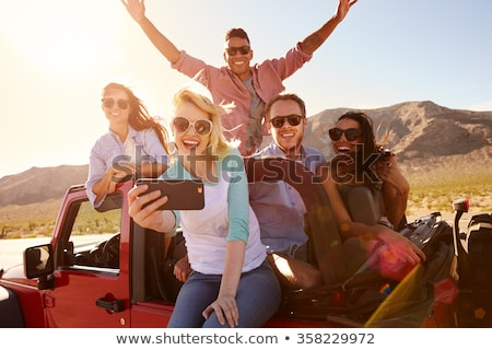 couple of travelers taking selfie by smartphone Stock photo © dolgachov
