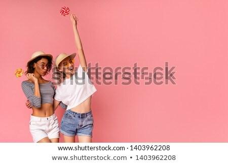 Dos bastante juguetón jóvenes ninas amigos Foto stock © deandrobot