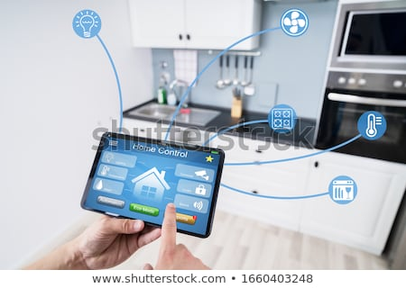 man holding cellphone with smart home application stock photo © andreypopov