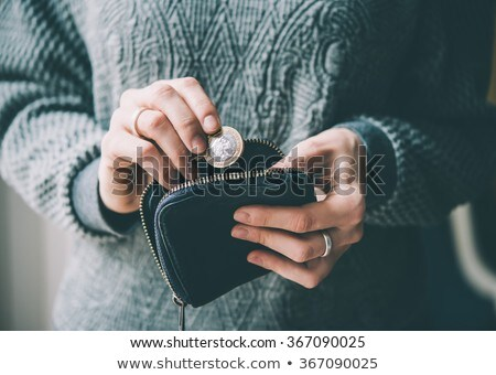 Holding colorful coin purses Stock photo © pressmaster