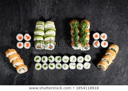 Close up of various types of japanese fresh prepared sushi. Stock photo © dash
