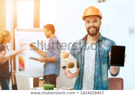 Foreman looking at blank plans Stock photo © photography33