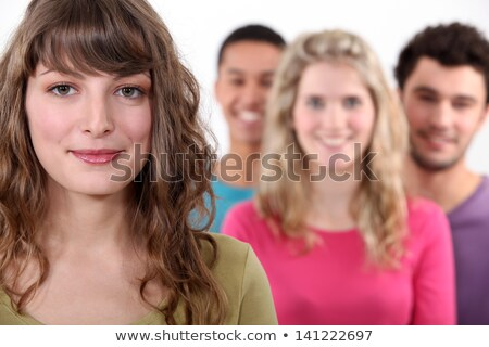 Woman standing in front of her peer group Stock photo © photography33