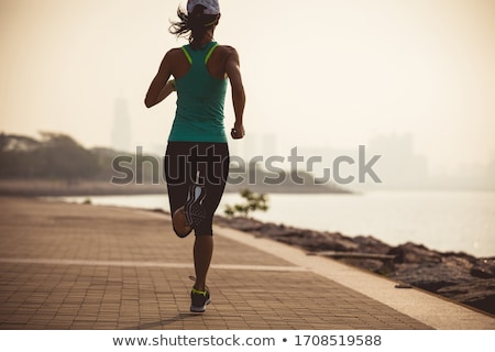Woman jogging by the coast Stock photo © photography33