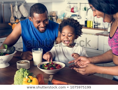 Kids eating in the kitchen Stock photo © photography33