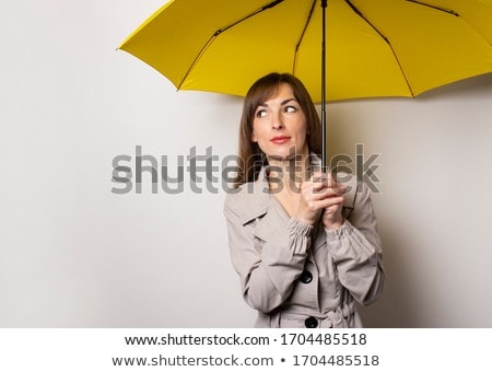 A fashionable woman holding an umbrella Stock photo © photography33