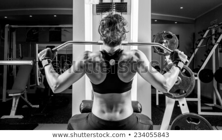 young brunette doing fitness in a fitness center Stock photo © photography33