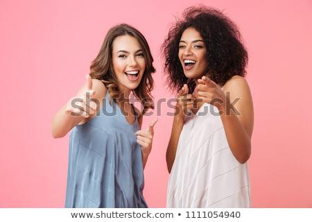 привлекательный · молодые · женщины · указывая · из · очаровательный - Сток-фото © stockyimages