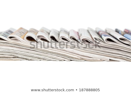 Stacked newspaper bundles on a white background Stock photo © Zerbor
