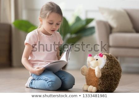 Kislány ül padló olvas mesekönyv otthon Stock fotó © wavebreak_media