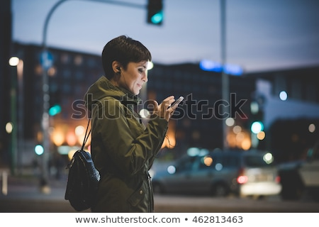 young woman with smartphone at night stock photo © dolgachov