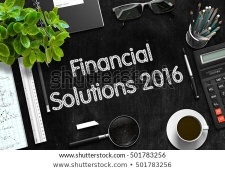 Financial Solutions 2016 on Black Chalkboard. 3D Rendering. Stock photo © tashatuvango