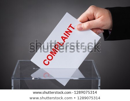 Person Inserting Complaint Letter Into Box Slot Stock photo © AndreyPopov