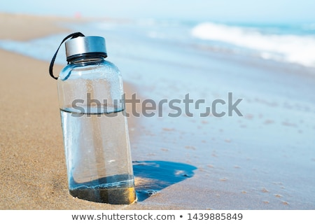 reusable water bottle on the beach Stock photo © nito