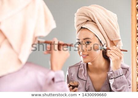 Kadın kil maske fırçalamak ev Stok fotoğraf © Elnur