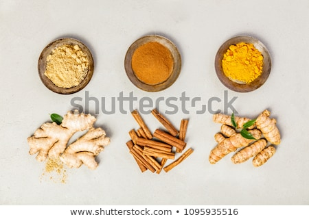 Powder of turmeric, cinnamon and ginger Stock photo © furmanphoto