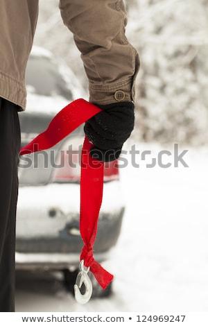 Man with towing rope hooks near towed car Stock photo © galitskaya