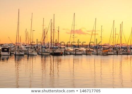 Moored sailboats reflecting in water Stock photo © elenaphoto