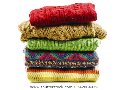 stack of colorful winter sweaters isolated on a white stock photo © lypnyk2