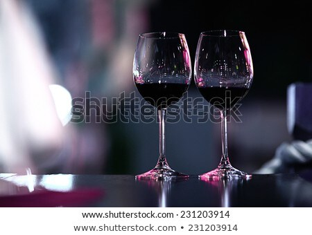 Stock photo: couple drinking red wine in a cellar