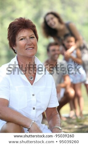 A grandmother enjoying a Sunday afternoon with her family. Stock photo © photography33