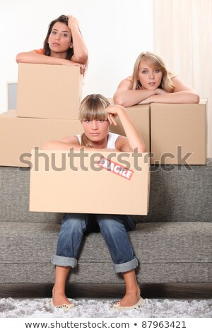 Three housemates with boxes Stock photo © photography33