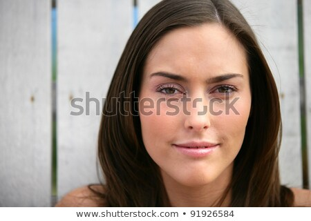 Woman stood in front of wooden fence Stock photo © photography33